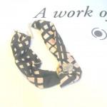 Collana con elementi in acciacio foglia oro tessuto 100% seta